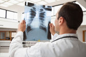 Doctor studying x-ray — Stock Photo