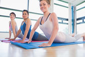 Smiling women at yoga class — Stock Photo