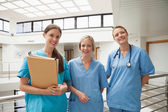 Three nurses in stairwell — Stock Photo