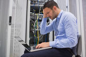 Technician becoming stressed over servers — Stock Photo