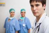 Satisfied doctor with two nurses — Stock Photo