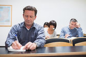 Adults in the classroom — Stock Photo