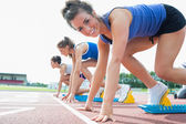 Happy woman at starting blocks — Stock Photo