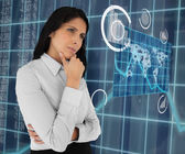 Woman standing thinking and looking at world map — Stock Photo