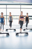 Aerobic group stepping — Stock Photo