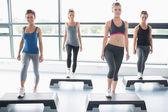 Four women doing aerobics — Stock Photo