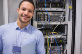 Man smiling in front of the servers — Stock Photo