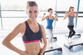 Smiling blonde at aerobics class — Stock Photo