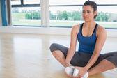 Woman doing bound angle yoga pose — Stock Photo
