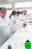 Happy chemist using tablet pc — Stock Photo