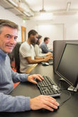 Smiling man working with the computer — Stock Photo