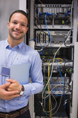 Man standing in front of servers — Stock Photo
