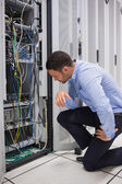 Technician looking at cables of the server — Stock Photo