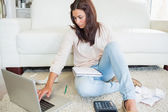 Woman calculating on the laptop — Stock Photo
