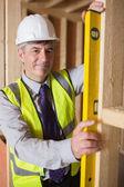 Man checking wooden frame — Stock Photo