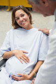 Pregant woman in wheelchair — Stock Photo