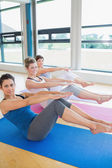 Women in yoga class doing boat pose — Stock Photo