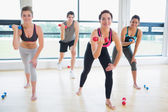 Smiling lifting wights in aerobics class — Stock Photo