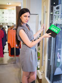Woman closing clothes store — Foto de Stock