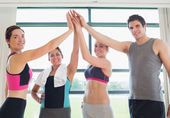 Smiling high fiving each other in gym — Stock Photo