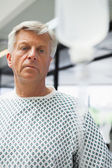 Sad patient with IV drip — Stock Photo