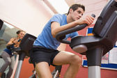 Man riding in a spinning class — Stock Photo