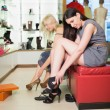 Stock Photo: Women searching for shoes