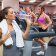Woman thirsty in gym — Stock Photo