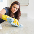 Concentrated woman scrubbing the bar — Stock Photo #23050042