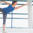 Woman in lord of the dance yoga pose — Stock Photo