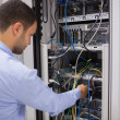 Man adjusting servers - Stock Photo