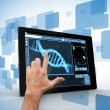 Man touching tablet pc with DNA interface — Stock Photo