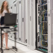 Woman pushing computer to open servers - Foto Stock