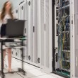 Woman pushing computer to open servers - Stok fotoraf