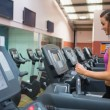 Woman running on a treadmill in a gym — Stock Photo #23050224