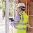 Man planning construction with tablet pc - Stok fotoğraf
