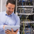 Data centre worker with tablet computer — Stock Photo #23050392