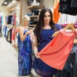 Woman holding clothes — Stock Photo #23050520