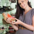 Stock Photo: Womholding shoe