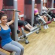 Stock Photo: Women training in weights room