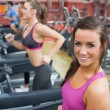 Royalty-Free Stock Photo: Women running on a treadmill in a gym smiling