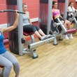 Four women training on weight machines — Stock Photo #23050822