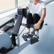 Stock Photo: Womon rowing machine