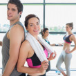 Man and woman standing back to back at the gym — Stock Photo