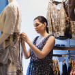 Woman is dressing a mannequin — Stockfoto