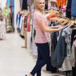 Stock Photo: Womis searching for clothes