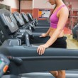 Stock Photo: Woman resting on the treadmill after exercising