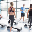 Trainer teaching his aerobic class - Stock Photo