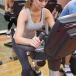 Woman training in a spinning class - Stock Photo