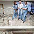 Doctor and two nurse standing on the stairs — Stock Photo